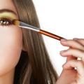 Beauty applying colorful eye makeup